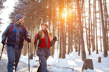 Love couple hiking on winter