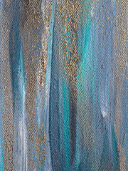 Artistic abstract colorful texture on canvas. Gold and blue paint stripes.