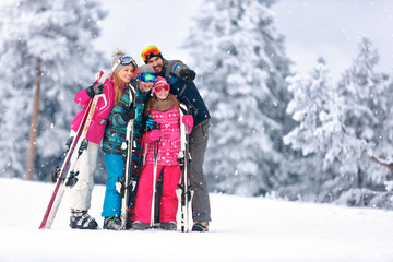 Family together skiing on mountain