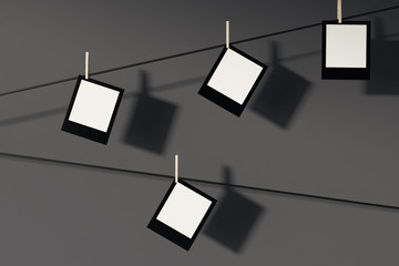 Photos on wires, gray background