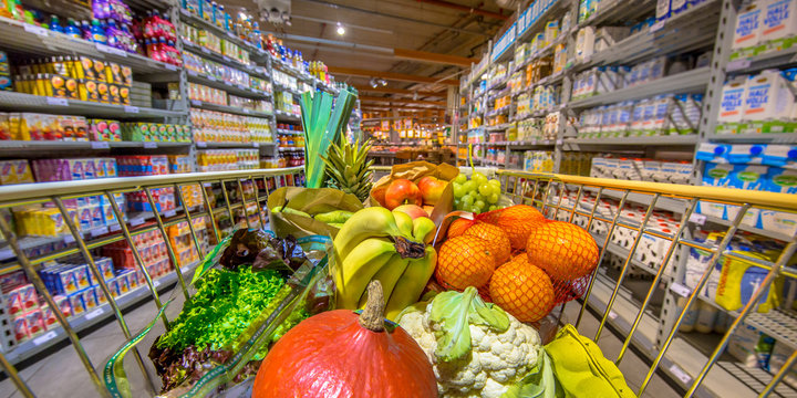 Panorama of Supermarket trolley with fruit and vegetables