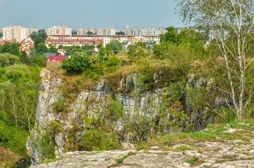 Summer urban landscape. View from Zakrzowek lagoon on the city of Krakow.