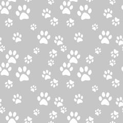 Vector seamless pattern with cat footprints. Can be used for wallpaper, web page background, surface textures.