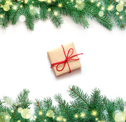 Christmas gift boxe and fir tree branch on white background. Top view.