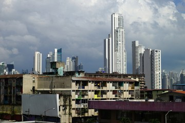 Poor neighborhood houses and skyscrapers on the background in Panama City, Panama