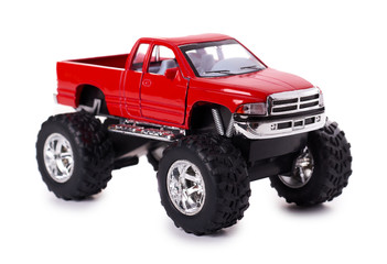 big metal red toy car offroad with monster wheels isolated on white background