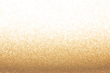 Golden (yellow) glitter background. Sparkle texture. Abstract gradient background blurred for New Years or Christmas holiday