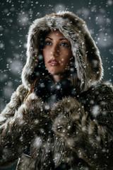 Girl Is Looking Through Snowflakes