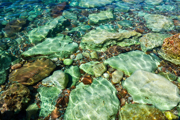 The sea view. Beautiful view from the mountain to the calm Adriatic sea. Blue clear water and large stones.