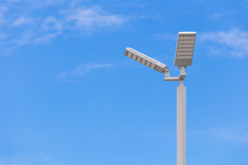 LED street light pole on blue sky with cloud