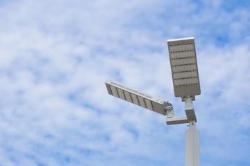 LED street light pole on blue sky with cloud