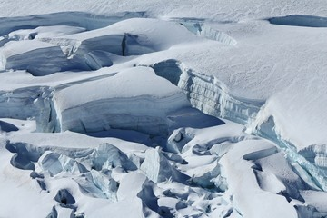 Crevasses with visible layers of ice. Detail of the Aletsch glacier.