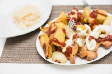 Chicken thighs, rustic potatoes, vegetables and sauerkraut.
