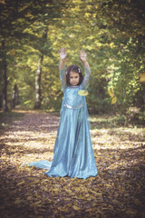 Little and happy girl playing in the woods,selective focus