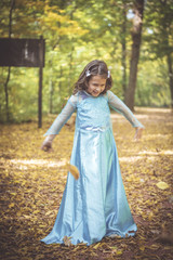 Playful little girl playing in the wood,blurred motion