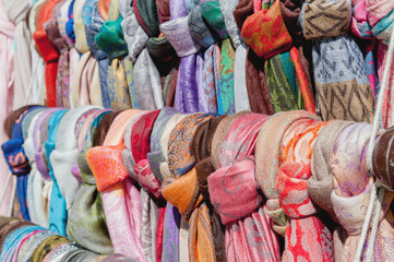 Showcase street of minimarket women's colorful scarves .