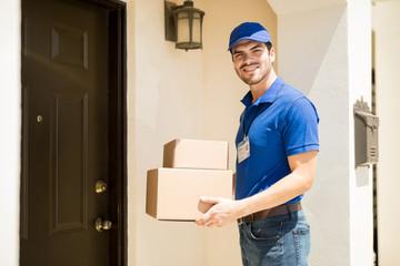 Delivery man bringing some parcels