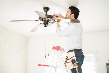 Handyman installing a ceiling fan