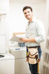 Handyman repairing a washer