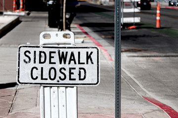 Sidewalk closed signs closing a sidewalk