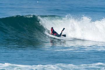 Bodyboarder surfing ocean wave