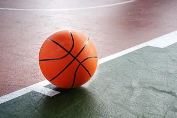 orange basketball on green brown court of gymnasium sport floor background