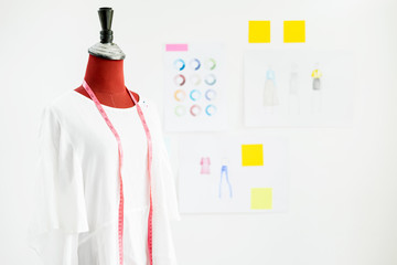 garment design on mannequin Red dummy with measuring tape in tailors fashion designer studio, Creative Design and Artistic Concept