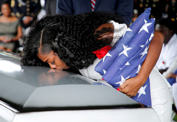 Myeshia Johnson, wife of U.S. Army Sergeant La David Johnson, who was among four special forces soldiers killed in Niger, kisses his coffin at a graveside service in Hollywood