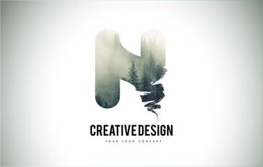 N Letter Brush with Forest Fog Texture. Forest Trees Letter Logo Design.