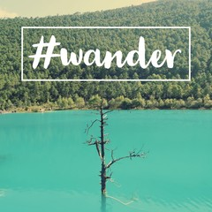 "Inspirational motivational travel quote ""wander"" on blue lake and mountain background."
