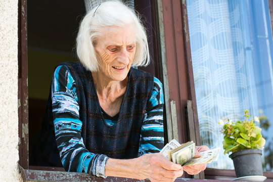 Grandma counting retirement money at home