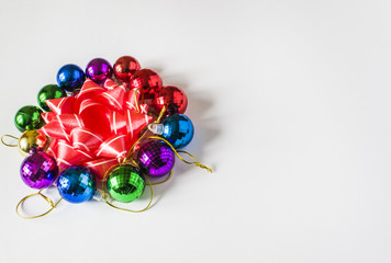 Red Christmas decorations on a light background. Christmas card. Winter holiday theme.