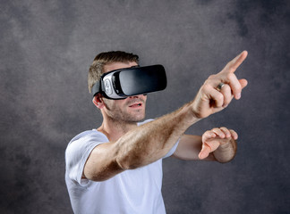 man with virtual reality glasses pointing upward