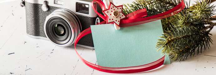 Christmas gift card and retro photo camera