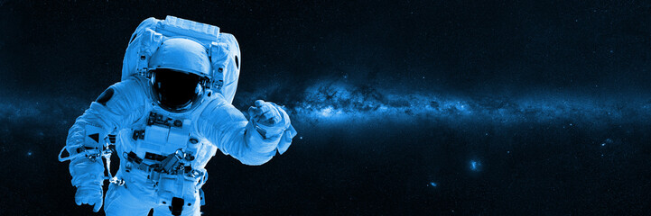 Astronaut in front of the Milky Way galaxy