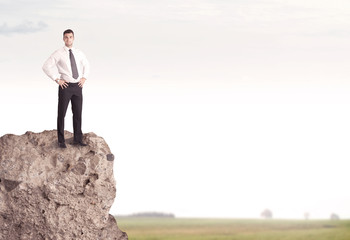 Happy salesman on cliff in the country
