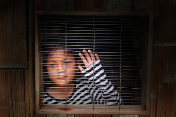 Asian girl in the cage, Human trafficking.