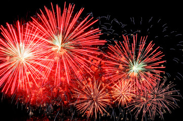 Amazing red fireworks and scattering of blue sparks