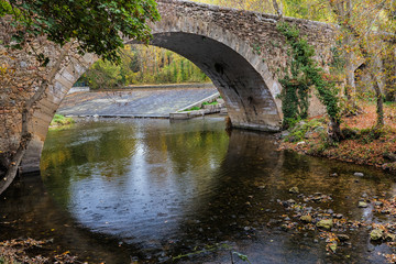 Stone Bridge over the Eresma river. Segovia. Spain.