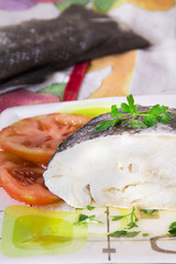 cod fillet in olive oil and tomato