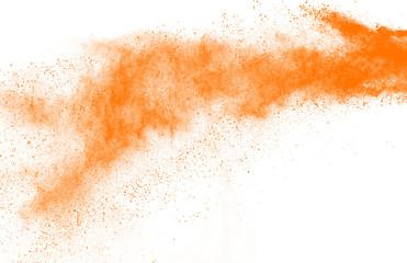 Freeze motion of orange powder explosions isolated on white background