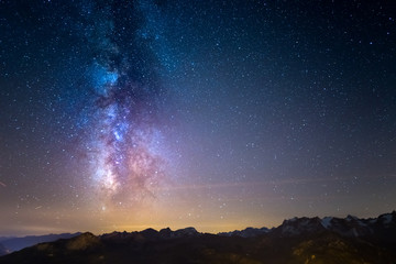 The Milky Way and the starry sky over the French Alps and the majestic Barre des Ecrins.