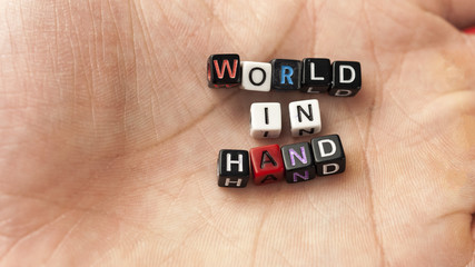 """Inscription from the letters in hand """"World in hand"""""""