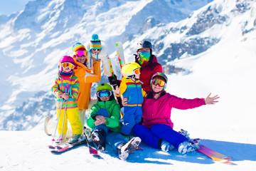 Ski and snow fun. Family in winter mountains.