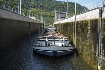 barge with scrap metal in locks in the Moselle River