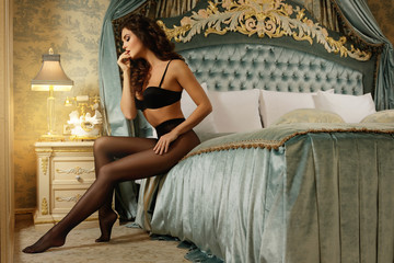 Sexy woman wearing a beautiful lingerie and a black tights