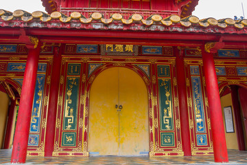 ornate door and facade of chinese temple