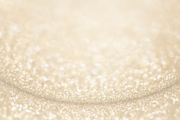 Light gold (yellow) glitter background. Sparkle texture. Abstract gradient background blurred for...