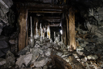 Old abandoned underground ore mica  mine shaft tunnel
