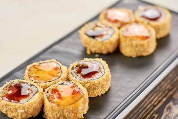 Delicious rolls unagi furai. Appetizing set of japanese sushi on plate. Asian traitional food.